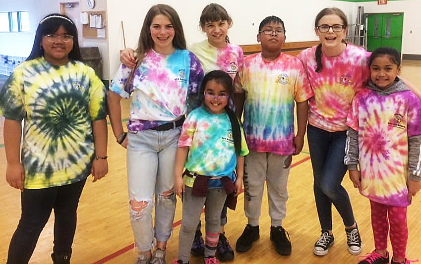 Seven Whittier Students in Tie Dye Shirts